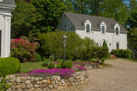 A view of the Carriage House and flowers